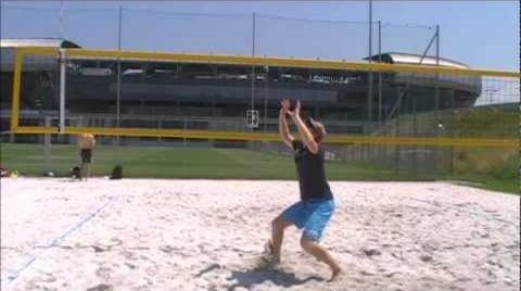 Setting a beach volleyball 3 of 3