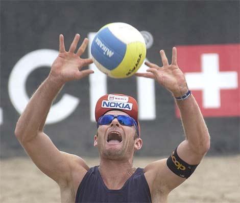 Setting a beach volleyball